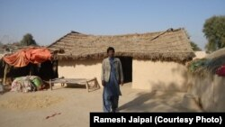 Ramesh Jaipal stands outside his family's home in Rahim Yar Khan, Pakistan.