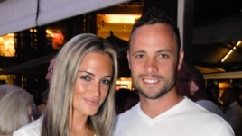 Olympian sprinter Oscar Pistorius posing next to his girlfriend Reeva Steenkamp at Melrose Arch in Johannesburg, Jan. 26, 2013.