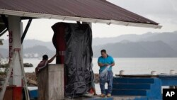 A marine gas station is shut down as it prepares for the arrival of Hurricane Earl, in Puerto Barrios, Guatemala, Aug. 3, 2016.