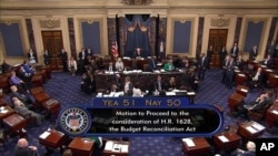 FILE - This image from video provided by C-SPAN2 shows the final Senate vote, with Vice President Mike Pence's vote, to start debate to tear down much of the Obama health care law, July 25, 2017, on the floor of the Senate on Capitol Hill in Washington.