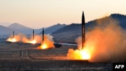 Undated photo released by North Korea's Korean Central News Agency (KCNA) via KNS on March 7, 2017 shows the launch of four ballistic missiles by the Korean People's Army (KPA) during a military drill at an undisclosed location in North Korea.
