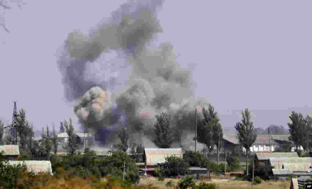 Smoke rises from a shell attack in the town of Novoazovsk, eastern Ukraine, Aug. 27, 2014.