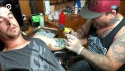 Американские тату-мастера начали бесплатно сводить расистские изображения