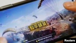 """""""Game for Peace"""", game buatan Tencent pesaing video game PUBG di China. (Foto Ilustrasi REUTERS/Florence Lo)"""