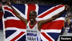 Britain's Mo Farah holds the Union Flag after winning the men's 10,000m final at the London 2012 Olympic Games at the Olympic Stadium August 4, 2012.