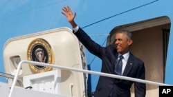 President Barack Obama waves as he boards Air Force One at Andrews Air Force Base, Md., Sept. 2, 2014, as he begins his trip to Estonia and Wales for the NATO Summit.