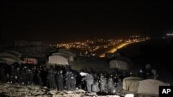 Cảnh sát Israel đuổi người Palestine ra khỏi những lều trại trong khu vực E-1 gần Jerusalem, ngày 13/1/2013.
