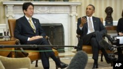 President Barack Obama meets with Japan's Prime Minister Shinzo Abe in the Oval Office of the White House in Washington, Friday, Feb. 22, 2013.