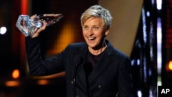 FILE - Ellen DeGeneres accepts the award for favorite daytime TV host at the 40th annual People's Choice Awards at the Nokia Theatre L.A. Live, Jan. 8, 2014.