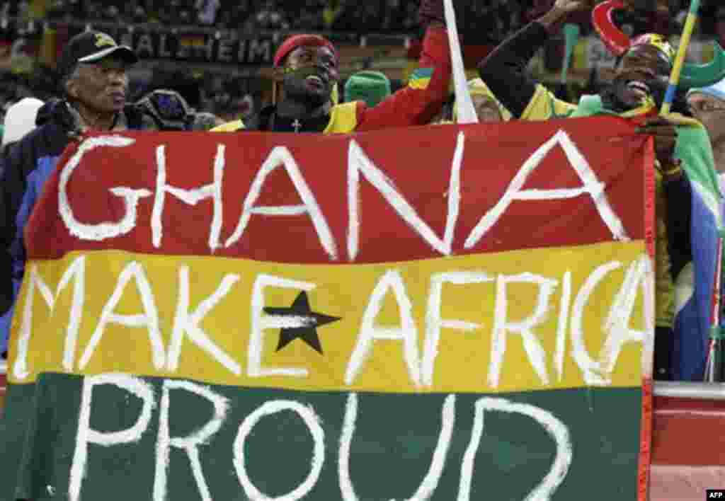 Ghana supporters cheer before the World Cup group D soccer match between Ghana and Germany at Soccer City in Johannesburg, South Africa, Wednesday, June 23, 2010. (AP Photo/Rebecca Blackwell)
