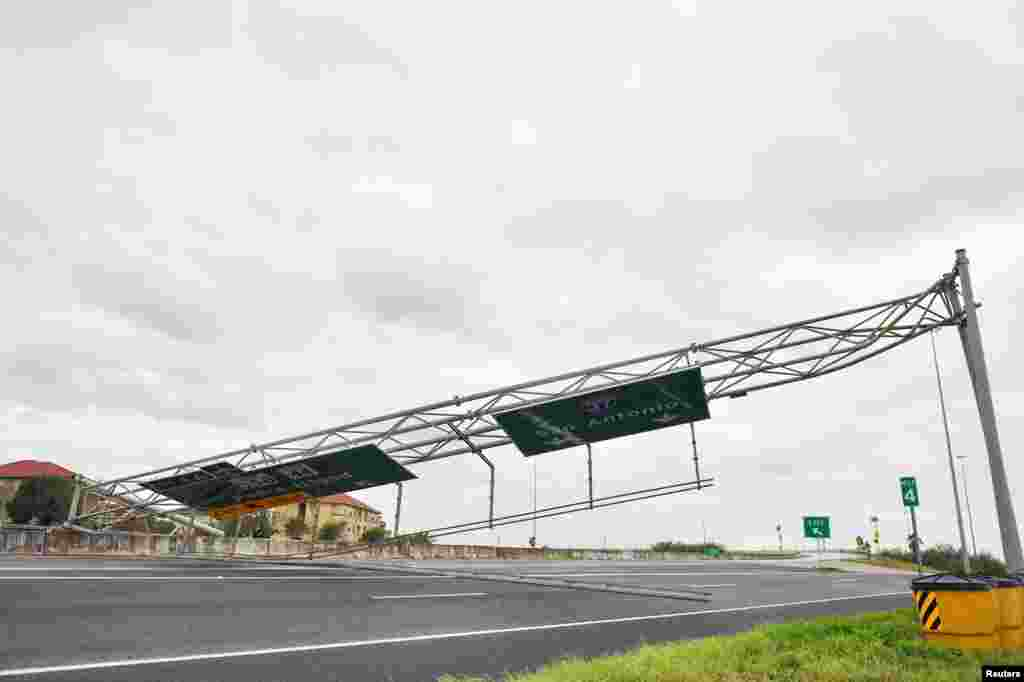 A collapsed overhead gantry lies across Interstate 37, blocking the highway due to damage caused by Hurricane Harvey in Corpus Christie, Texas, Aug. 26, 2017.