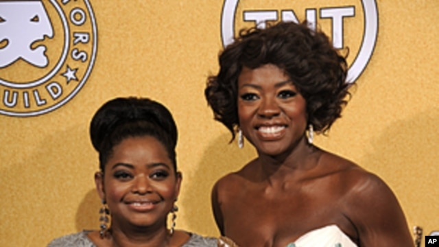 "Octavia Spencer, winner of award for outstanding performance by a female actor in a supporting role for ""The Help,"" left, and Viola Davis, winner of the award for outstanding performance by a female actor in a leading role for ""The Help,"" pose backstage a"