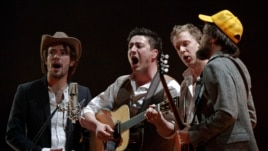 Mumford & Sons perform on stage during the BRIT music awards at the O2 Arena in London February 15, 2011.