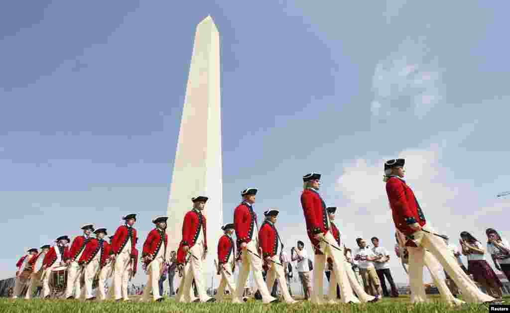 Members of the Fife and Drum Corps march during the re-opening ceremony for the Washington Monument in Washington May 12, 2014.
