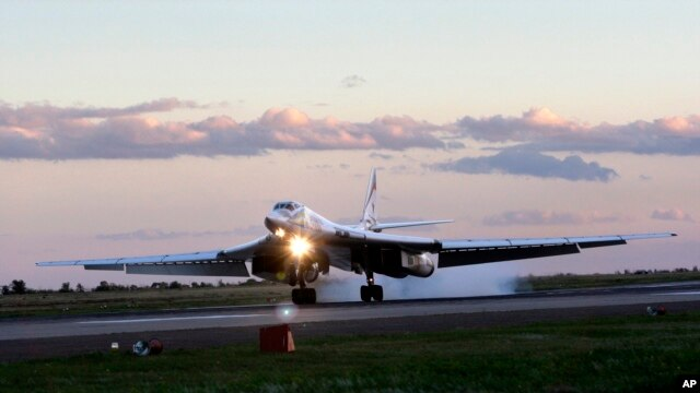 FILE - Russia's strategic bomber Tu-160 or White Swan, the largest supersonic bomber in the world, lands at Engels Air Base near Saratov, about 700 kilometers (450 miles) southeast of Moscow, Aug. 7, 2008.