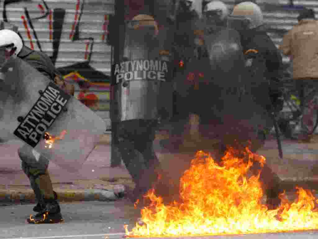 Riot police try to avoid a gasoline bomb during clashes in Athens, February 10, 2012. (AP)