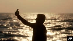 n this Feb. 22, 2016, photo, an Indian man takes a selfie in Mumbai's coastline. India is home to the highest number of people who have died while taking photos of themselves, with 19 of the world's 49 recorded selfie-linked deaths since 2014,