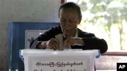 FILE - A woman casts her ballot at a local polling station in Bago, about 90 kilometers northeast of Yangon, Myanmar.