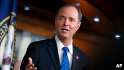 FILE - House Intelligence Committee Chairman Adam Schiff, D-Calif., talks to reporters about the release by the White House of a transcript of a call between President Donald Trump and Ukrainian President Voldymyr Zelenskiy, at the Capitol in Washington, Sept. 25, 2019.