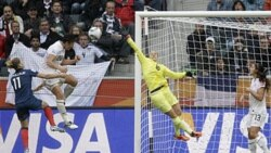 The United States' Abby Wambach, in white shirt, left, scores the second goal for her team in the semifinal. The United States defeated France 3-1.