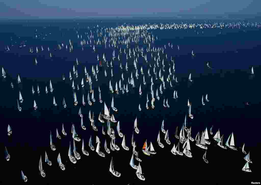 Sailboats gather during the Barcolana regatta in front of the Trieste harbor, Italy.
