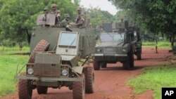 Ugandan troops patrol town of Zemio in Central African Republic, where they are hunting down fugitive members of the Lord's Resistance Army, June 25, 2014.