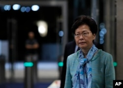 Hong Kong Chief Executive Carrie Lam listens to reporters questions during a press conference in Hong Kong, Tuesday, July 2, 2019.