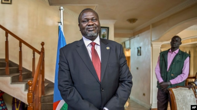 FILE - South Sudan's rebel leader Riek Machar. Despite the moves toward solidarity, fighting continues in parts of South Sudan.