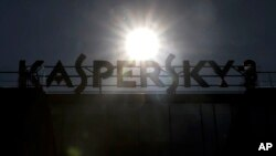 A sign above the headquarters of Kaspersky Lab in Moscow, Russia, Saturday, July 1, 2017. The chief executive of Russia's Kaspersky Lab, Eugene Kaspersky, says he's ready to have his company's source code examined by U.S. government officials to help disp