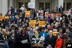 New York City Council Speaker Melissa Mark-Viverito, center, speaks during an interfaith rally at New York's City Hall in response to Republican presidential candidate Donald Trump's call to block Muslims from entering the U.S., Dec. 9, 2015.