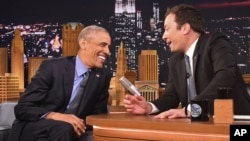 "President Barack Obama, left, shares a laugh with host Jimmy Fallon on the set of the ""The Tonight Show Starring Jimmy Fallon,"" at NBC Studios in New York, June 8, 2016."