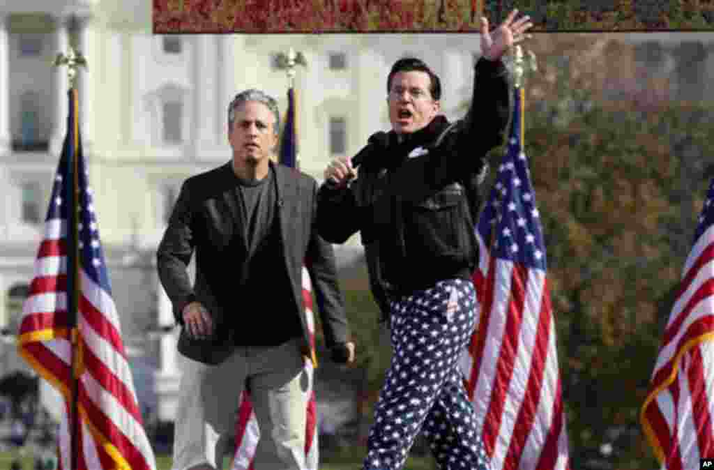 "Comedians Stephen Colbert, right, and Jon Stewart perform in front of the U.S. Capitol during their Rally to Restore Sanity and/or Fear on the National Mall in Washington, Saturday, Oct. 30, 2010. The ""sanity"" rally blending laughs and political activism"