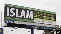 A billboard offering information about Islam is seen on a main road in west Sydney. The billboards, paid by an Islamic group called MyPeace, offer free information about Islam, a free copy of the Koran and other Islamic literature, (File photo June 10, 20