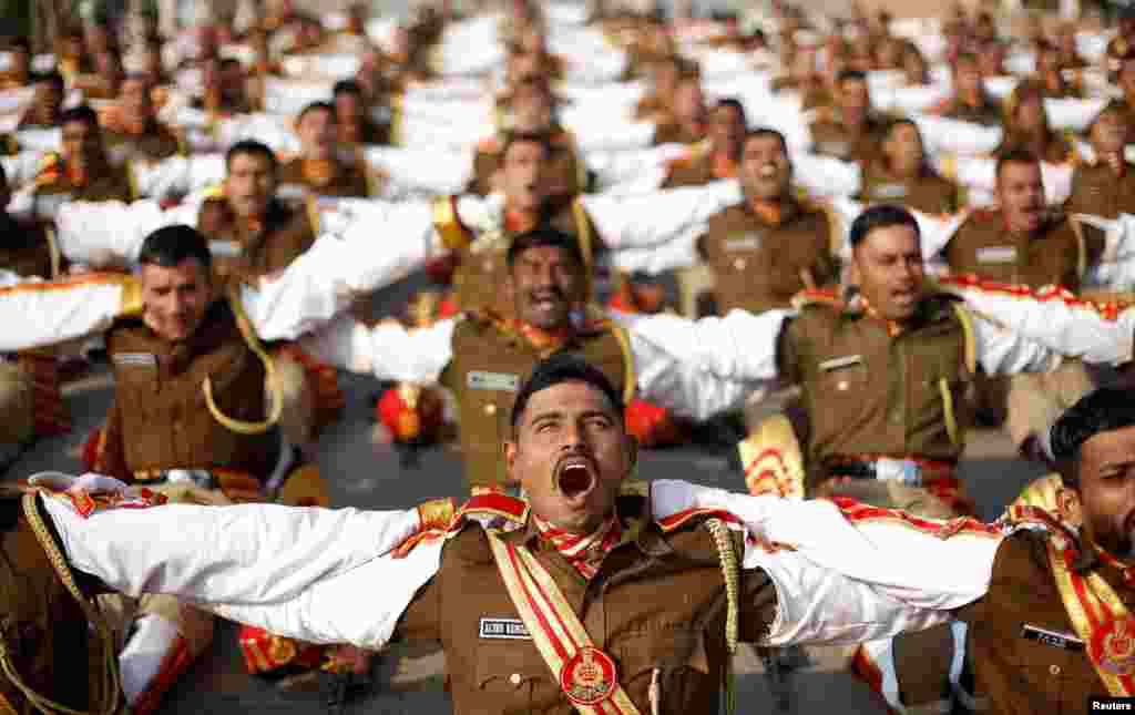 Indian soldiers take part in a laughter yoga session during their rehearsal for the Republic Day parade on a winter morning in New Delhi, India.
