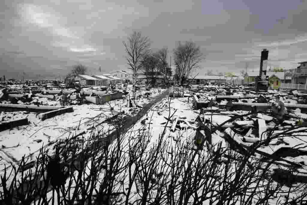 The fire-scorched landscape of Breezy Point in New York, which was devastated during Superstorm Sandy when a fire pushed by the raging winds destroyed many homes, is seen after a Nor'easter snow, November 8, 2012.