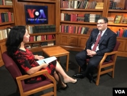 Uzbekistan's Justice Minister Ruslanbek Davletov talking to Navbahor Imamova, VOA, May 15, 2018