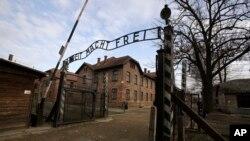 The gate of the Auschwitz I Nazi death camp in Oswiecim, Poland, Monday, Jan. 27, 2020.