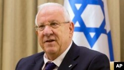 "FILE - Israel President Reuven Rivlin, pictured in November 2014, says Israel and Mexico ""can put the issue behind us"" — a reference to Israeli Prime Minister Benjamin Netanyahu's tweet that appeared to praise the idea of a border wall between the U.S. and Mexico."