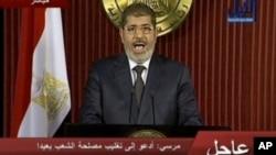 ປະທານາທິບໍດີ Mohamed Morsi ໄດ້ປະຕິເສດທີ່ຈະຍົກເລີກ ການລົງປະຊາມະຕິເພື່ອຮັບຮອງເອົາຮ່າງລັດຖະທຳມະນູນ