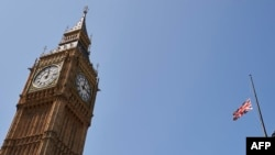 The British flag flies at half-staff above Portcullis House beside the landmark Elizabeth Tower, more commonly known as Big Ben, in central London in tribute to the victims of a jihadist massacre in Tunisia, July 3, 2015.