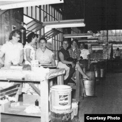 Women workers inside the Gibson guitar factory during World War II. (Photo by Margaret Hart)