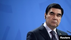 FILE - President of Turkmenistan Gurbanguly Berdimuhamedow attends a news conference at the Chancellery in Berlin, Germany, Aug. 29, 2016.