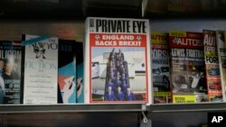 A copy of the satirical Private Eye magazine is displayed for sale with a Brexit themed cover in a store in London, Wednesday, June 8.