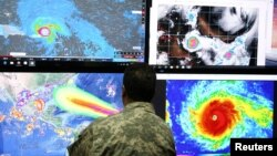 A member of the Emergency Operations Committee (COE) monitors the trajectory of Hurricane Irma in Santo Domingo, Dominican Republic, Sept. 5, 2017.