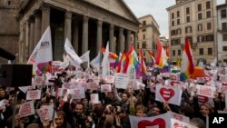 Activists demonstrate in favor of rights for gay couples prior to a debate to be opened in Italian parliament to change laws on recognition of rights for same-sex couples, in Rome, Jan. 23, 2016.