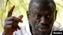 "FILE - Opposition leader Kizza Besigye speaks during a news conference at his home at the outskirts of Kampala, Uganda, Feb. 21, 2016. His lawyer says the latest charges against his client are ""just harassment."""