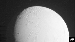 FILE - The Cassini spacecraft captured this of Saturn's moon Enceladus, in a flyby Oct. 28, 2015. The U.S.-European spacecraft skimmed within 30 miles of the south pole. (NASA/JPL-Caltech/Space Science Institute via AP)