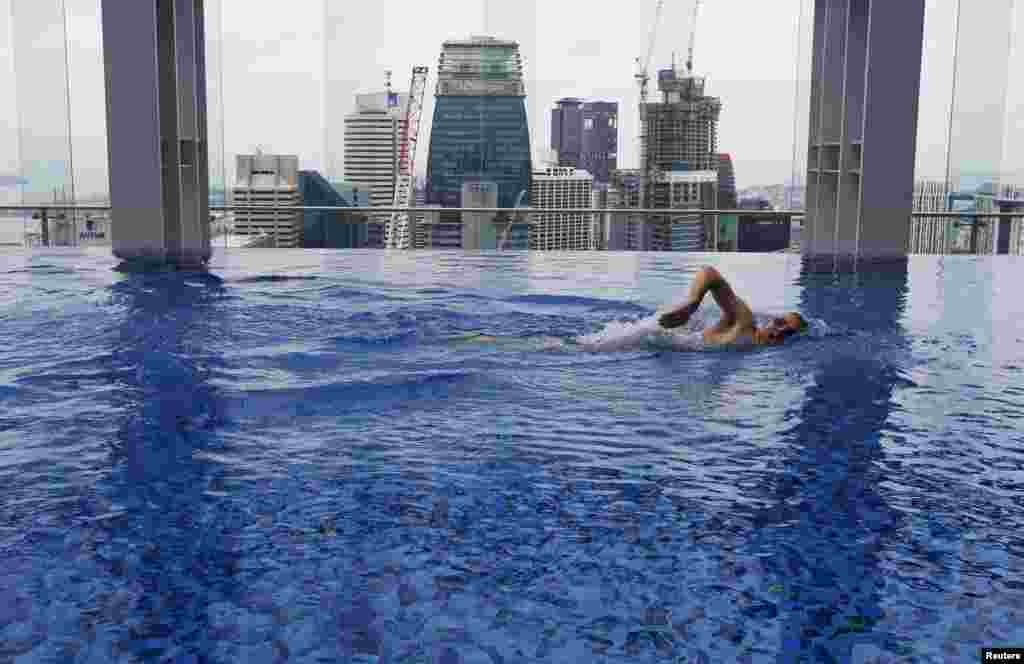 Fitness coach Peter Yeoman swims in the pool of Gravity health and fitness club in Singapore's central business district (CBD).