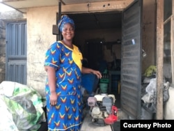 Adejoke Oyewale, 52, volunteers as a community advocate to combat domestic and sexual violence in her community in Ejigbo, Lagos. (Photo by Declan Cooley)
