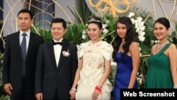 The elite guests attended the wedding of Sok Sokan, the son of the late Council of Ministers President Sok An, and Sam Ang Leakhena whose parents own Vattanac Capital, in June. (Web Screenshot)